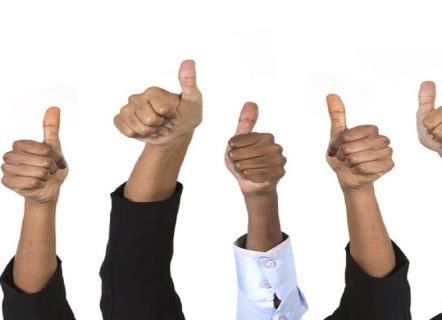 Close-up of a team of Indian business men and women's with Thumbs Up upward