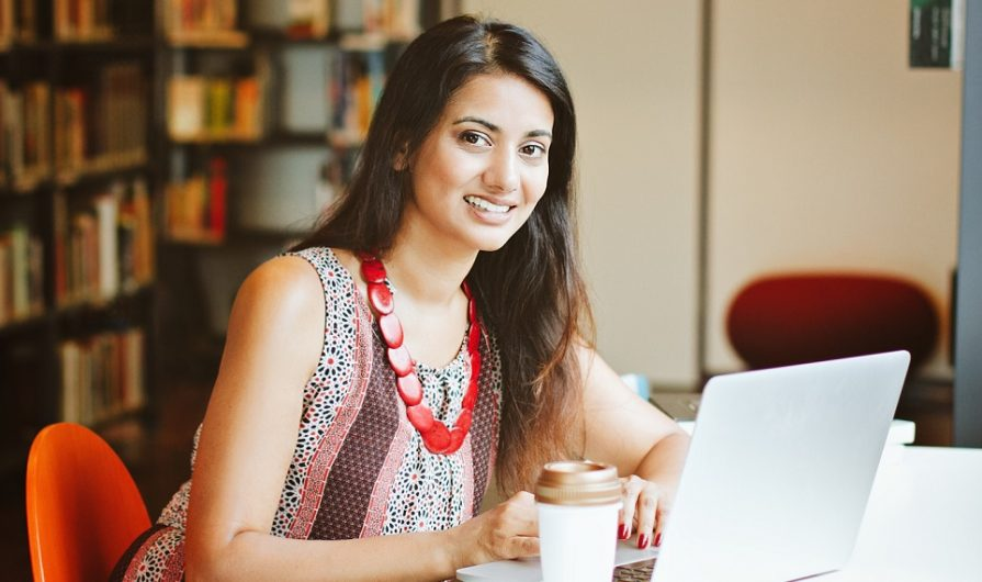 Indian woman works on laptop